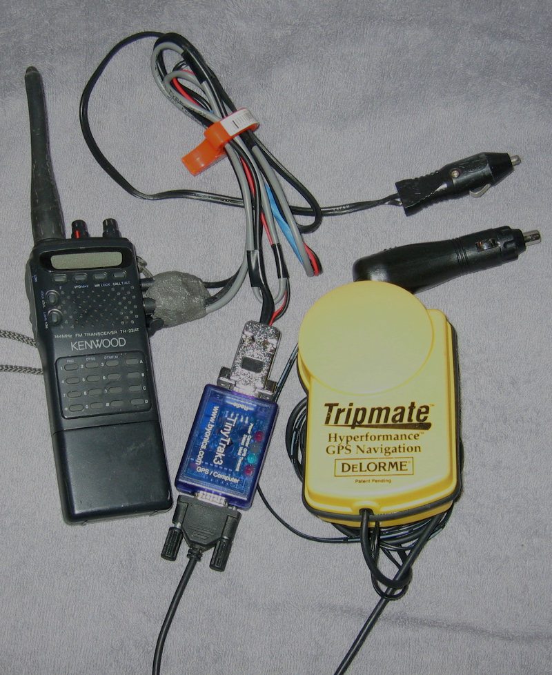 Picture of my first APRS rig, a Kenwood TH-22AT, Byonics TinyTrak3, and a DeLorme GPS